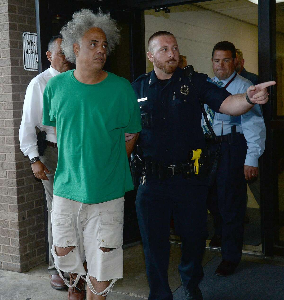 Ronald Goeloe, 51, of Beaumont is led out of the Beaumont Police Department Friday after being arrested and charged with murder in the death of Joyce Marie Acey, 49, of Beaumont. Acey's body was found dead in a garage apartment on Evalon Avenue Thursday night. Photo taken Friday, July 19, 2019 Kim Brent/The Enterprise