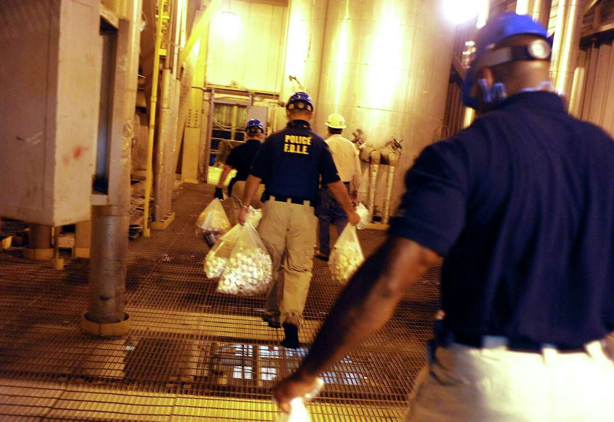 In this Aug. 15, 2011 photo, Florida Department of Law Enforcement officers carry bags of prescription drugs that were confiscated from a clinic to be burned in an incinerator facility in Coconut Creek, Fla. Floridaa€™s a€˜pill millsa€™ were a gateway to the nationa€™s opioid crisis, feeding addiction and overdoses in Appalachia and other states. They exploded across Florida in the early 2000s and operated for years with little oversight. The release this week of July 19, 2019, of a trove of federal data showing the distribution of opioids across the U.S. put the spotlight again on Floridaa€™s notorious a€˜pill mills,a€™ which provided the seeds of an epidemic that continues to cost tens of thousands of lives each year. (Carey Wagner, South Florida Sun Sentinel via AP)
