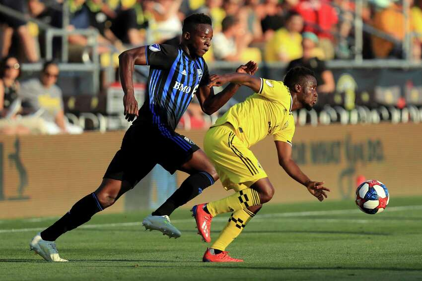 Montreal Impact's Zakaria Diallo, left, gives chase to Columbus Crew's David Accam as they battle for the ball during the first half of an MLS soccer match, Saturday, July 20, 2019, in Columbus, Ohio. (AP Photo/Aaron Doster)