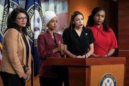 "U.S. Reps. Rashida Tlaib, from left, llhan Omar, Alexandria Ocasio-Cortez and Ayanna Pressley - known as The Squad - respond to President Donald Trump, who called on them to go back to their ""broken"" countries. Were they targeted because of their heritage or their stances?"