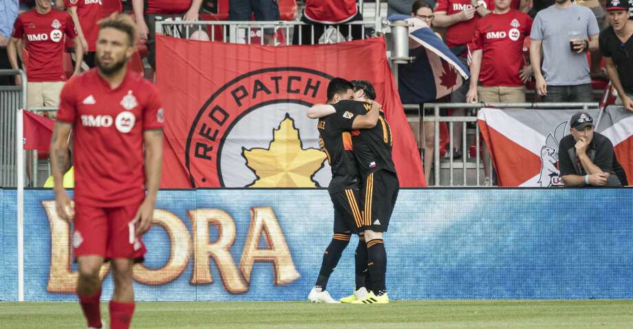 Houston Dynamo midfielders Tomas Martinez (10) and  Thomas McNamara (11) celebrate after a goal during the first half of an MLS soccer game, Saturday, July 20, 2019 in Toronto. (Christopher Katsarov/The Canadian Press via AP) Photo: Christopher Katsarov/Associated Press