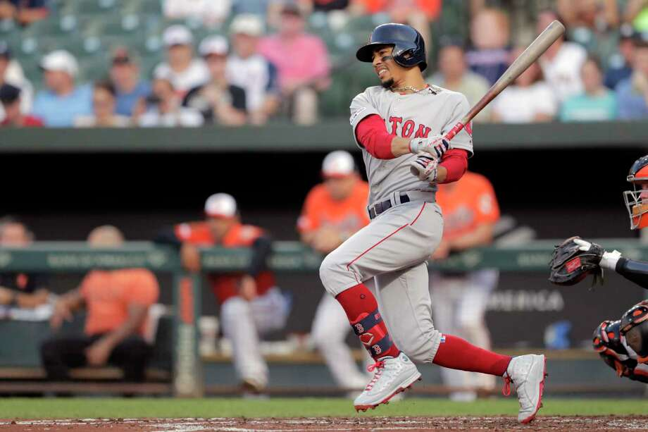 Boston Red Sox's Mookie Betts swings at a pitch from Baltimore Orioles starting pitcher Thomas Eshelman during the second inning of a baseball game, Saturday, July 20, 2019, in Baltimore. (AP Photo/Julio Cortez) Photo: Julio Cortez / Copyright 2019 The Associated Press. All rights reserved.