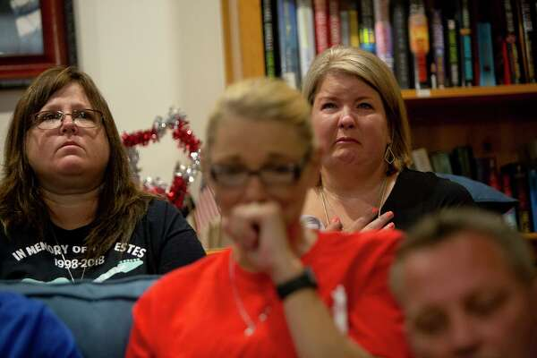 Michele Frizzell, right, the mother of fire victim Haley Frizzell, who was killed in the fire at Iconic Village Apartments in San Marcos that took five lives and critically injured Zachary Sutterfield, speaks about the impact of the fire on the one-year-anniversary. Four families of victims joined fire survivor Zachary Sutterfield and his parents at the Fisher House where they are living while Zachary contines treatment at Joint Base San Antonio-Fort Sam Houston on July 20, 2019. Next to Frizzell is Cheryl Estes, the mother of victim Dru Estes, and in front are DJ and Karl Sutterfield, Zachary's parents.