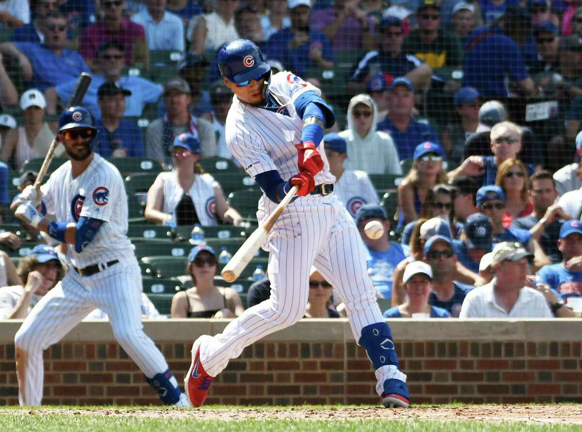 CHICAGO, ILLINOIS - JULY 20: Javier Baez #9 of the Chicago Cubs hits a three-run home run against the San Diego Padres during the fourth inning at Wrigley Field on July 20, 2019 in Chicago, Illinois. (Photo by David Banks/Getty Images)
