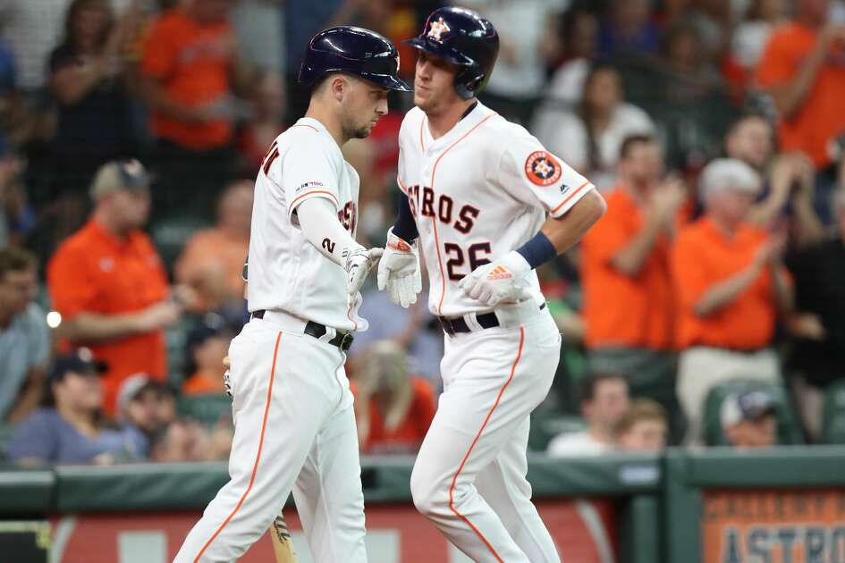 Houston Astros center fielder Myles Straw (26) rounds the bases as he his hit home by Houston Astros center fielder George Springer (4) during the third inning of an MLB baseball game at Minute Maid Park Saturday, July 20, 2019, in Houston.