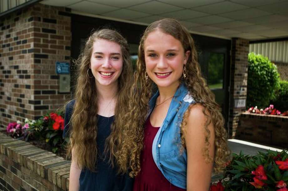 Elaiyna Schwartzkopf, right, and Sara Lawrence pose for a portrait at Calvary Baptist Academy. (Katy Kildee/kkildee@mdn.net)