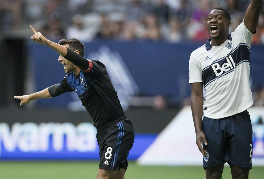 Earthquakes forward Chris Wondolowski (8) celebrates after scoring in the first half against the Vancouver Whitecaps. Photo: Darryl Dyck / Associated Press