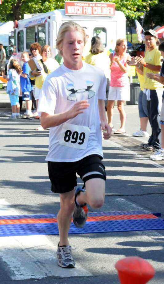 Connor Case, 16, of New Milford took first place in the 5K road race.  New Milford Park and Recreation 5k and 8 mile road race was held on the New Milford green on Sat. July 31, 2010. Photo: Lisa Weir / The News-Times Freelance