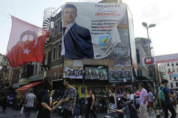 A poster celebrates the election victory of Ekrem Imamoglu as mayor of Istanbul in Istanbul on June 25, 2019.