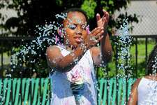 Diamond Epps, 7, of Bridgeport, plays at the splash pad at Longbrook Park in Stratford, Conn., on Thursday July 5, 2019.
