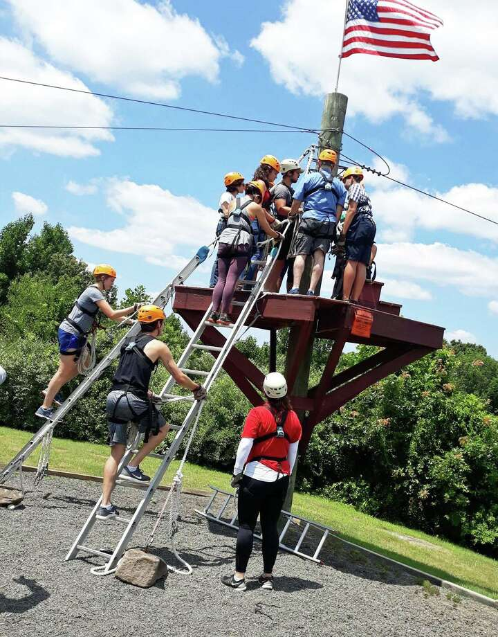 Eleven adults and young people participants visited Empower Leadership Sports and Adventure Center in Middletown July 13 for a warm weather session of zip lining as part of a Nutmeg Big Brothers Big Sisters' program. Photo: Contributed Photo