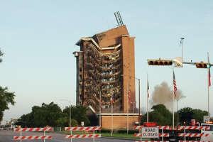 The Pasadena Bank Building falls as explosive charges are set off during implosion Sunday, Jul.21.
