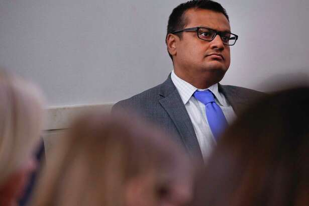 Deputy White House press secretary Raj Shah, watches White House press secretary Sarah Huckabee Sanders speak to the media during the daily press briefing in the Brady Press Briefing Room of the White House, Thursday, June 14, 2018. (AP Photo/Pablo Martinez Monsivais)