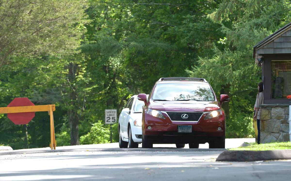 Cars enter Squantz Pond State Park, in New Fairfield. When the park's parking lot is at capacity the state closes the park to cars, but still allows walk-ins. That has become a concern for the Town of New Fairfield. People are parking around town and walking to the park on roads with no shoulders. Saturday, August 15, 2015, in New Fairfield, Conn.