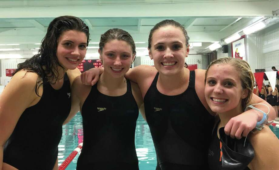Ridgefield High swimmers Stephanie Bishop, Rylie Giles, Anna Turner, and Hannah Snyder (left to right) earned All-America honors in a relay event. Photo: Contributed Photo / Ridgefield Girls Swimming