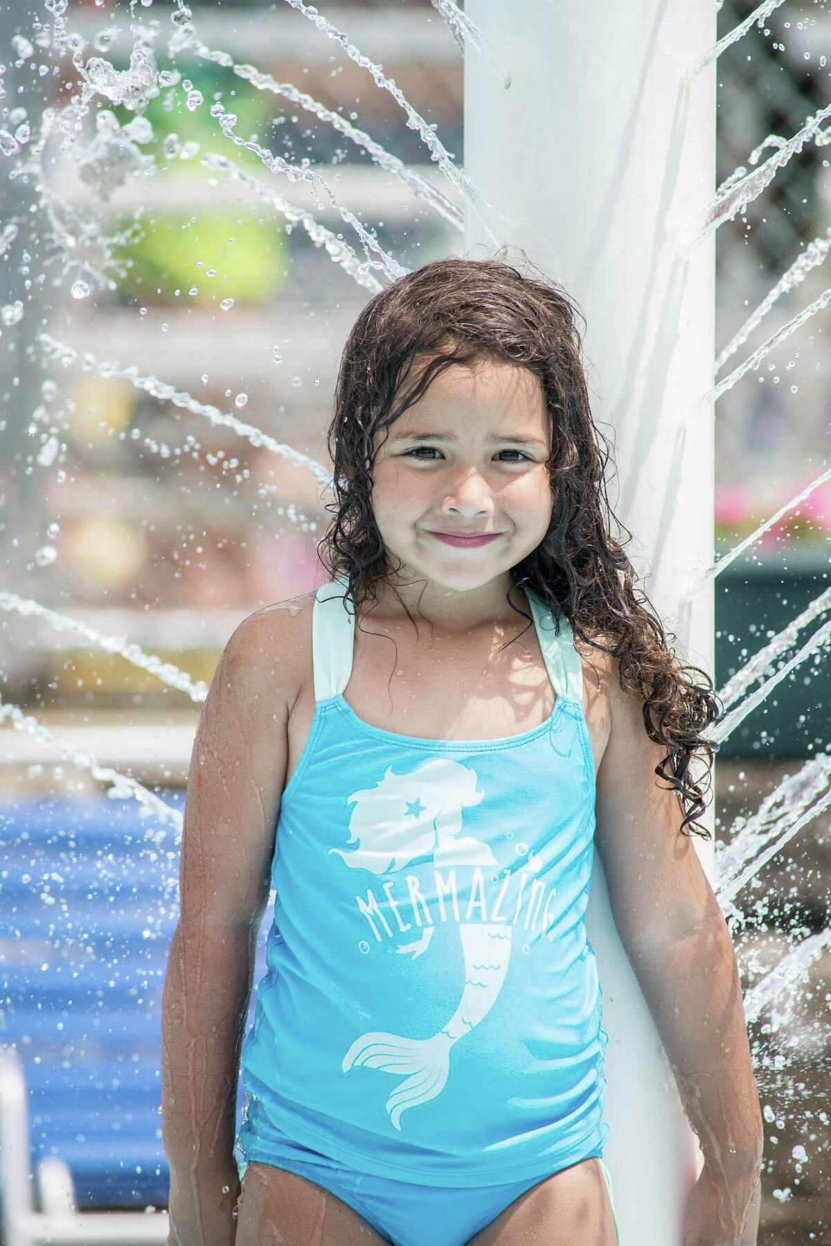 Five-year-old Briana Betancourt cools down at the Y.