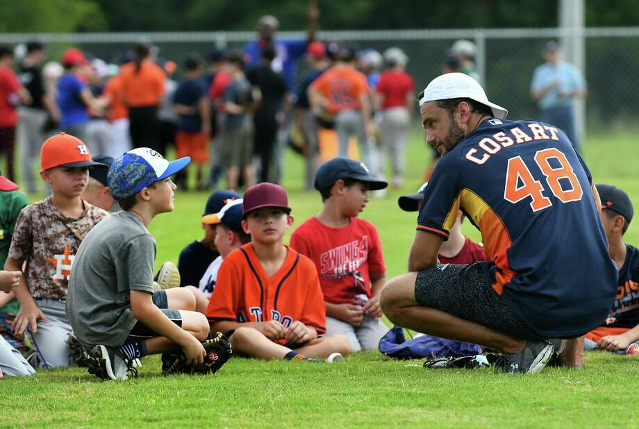 Former Major League Baseball player Jarred Cosart, right, leads his group in a discussion of hitting fundamentals during the Legends for Youth Baseball Clinic at Legacy the School of Sports Sciences in Spring on July 19, 2019. Photo: Jerry Baker, Houston Chronicle / Contributor / Houston Chronicle
