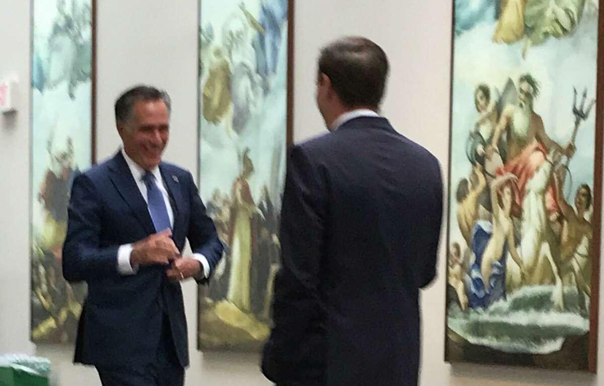 U.S. Senator Chris Murphy (D-CT), right, introduces Senator Mitt Romney (R-UT), at Connecticut in the Capital day last week in Washington, D.C.