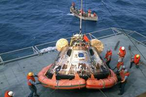 The Apollo 11 Command Module, Columbia, is hoisted aboard the USS Hornet in the Pacific recovery area, about 812 nautical miles southwest of Hawaii, on July 24, 1969.