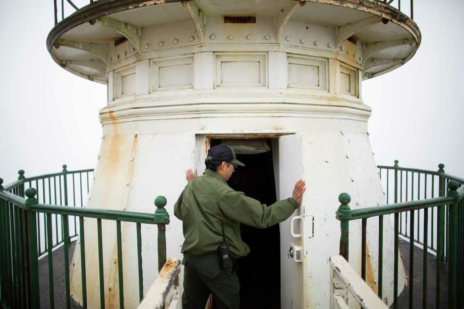 National Park ranger Doug Her opens the door of the historic Point Reyes lighthouse, Point Reyes Station, California, August 3rd, 2018. The historic Point Reyes lighthouse will close this weekend for two months for major renovation, repaving, rebuilding visitor center and fixing up the old and very complicated lighthouse lens. Photo: Talia Herman / ONLINE_YES
