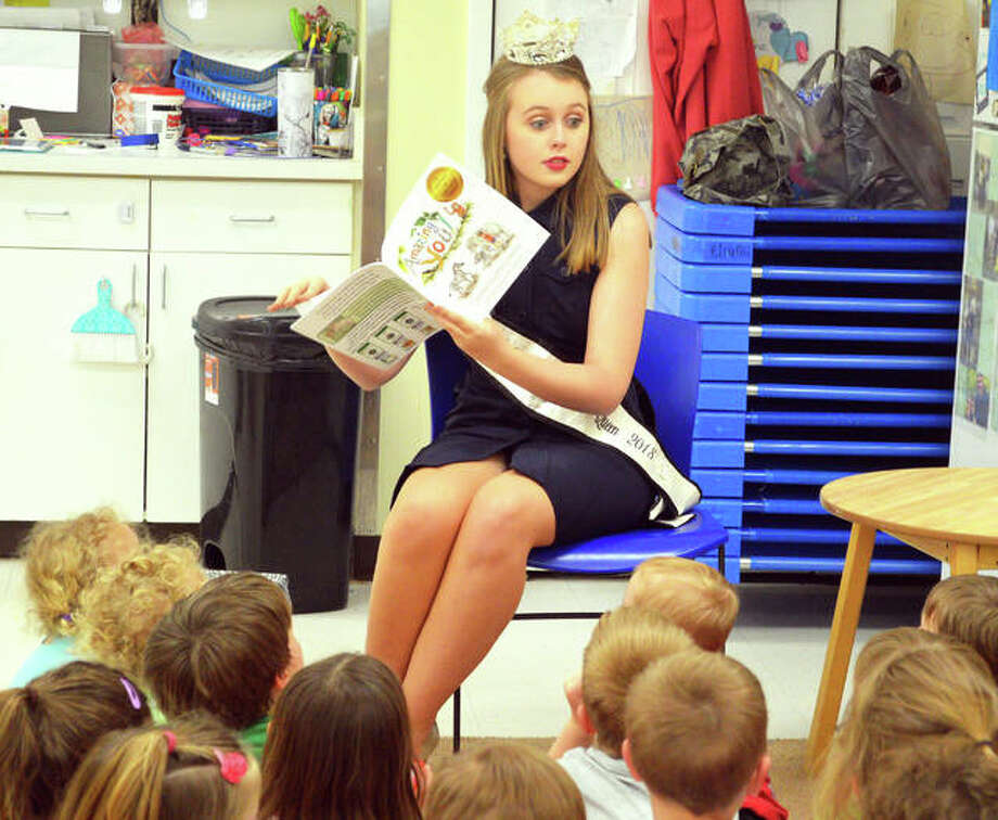 In this April 2019 file photo, Missy Huddleston, Miss Madison County Fair 2018, reads a story to preschoolers at Early Explorations Too in Glen Carbon. This year's pageant is Saturday, July 27, during the Madison County Fair July 23-28. Photo: Scott Marion | Intelligencer File Photo