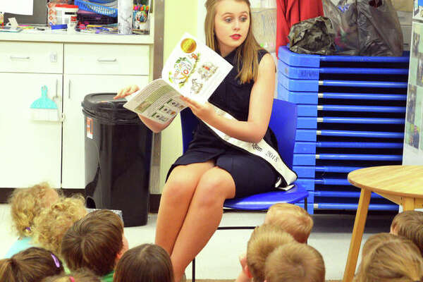 In this April 2019 file photo, Missy Huddleston, Miss Madison County Fair 2018, reads a story to preschoolers at Early Explorations Too in Glen Carbon. This year's pageant is Saturday, July 27, during the Madison County Fair July 23-28.