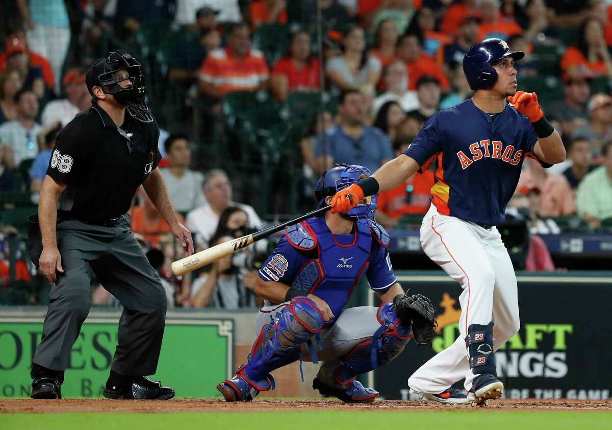 Houston Astros Michael Brantley (23) hits a two-run home run off of Texas Rangers starting pitcher Lance Lynn during the first inning of an MLB baseball game at Minute Maid Park, Sunday, July 21, 2019.