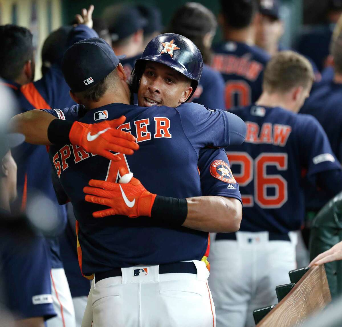 Houston Astros Michael Brantley (23) celebrates his two-run home run off of Texas Rangers starting pitcher Lance Lynn with George Springer during the first inning of an MLB baseball game at Minute Maid Park, Sunday, July 21, 2019.