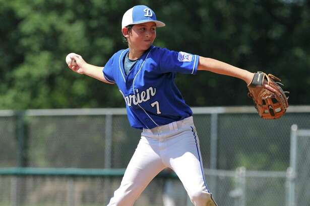Aiden Elders (7) of Darien delivers a pitch during a Section 1 game against Fairfield American on Sunday July 21, 2019 at Unity Park in Trumbull, Connecticut.