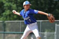 Aiden Elders (7) of Darien delivers a pitch during a Section 1 game against Fairfield American on Sunday at Unity Park in Trumbull.