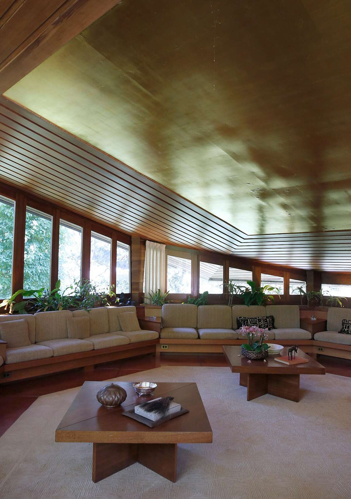 The octagonal living room of the Maynard Buehler House, designed by Frank Lloyd Wright, in Orinda, Calif. on Friday, July 19, 2019. The Usonian house designed by the legendary American architect is among the homes available to tour through the Frank Lloyd Wright Revival Initiative.