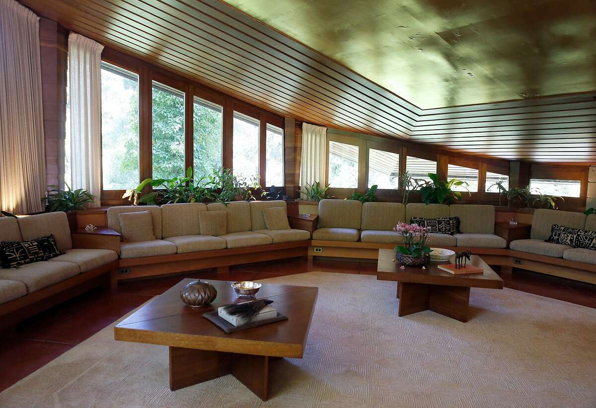 The living room of the Maynard Buehler House, designed by Frank Lloyd Wright, in Orinda, Calif. on Friday, July 19, 2019. The Usonian house designed by the legendary American architect is among the homes available to tour through the Frank Lloyd Wright Revival Initiative.