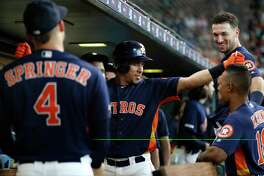 Houston Astros left fielder Michael Brantley (23) celebrates his second home run of the day with Tony Kemp (18) during the eighth inning of an MLB baseball game at Minute Maid Park, Sunday, July 21, 2019.