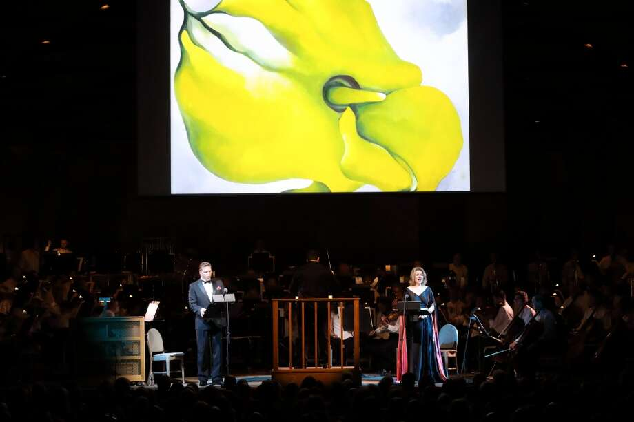 "The passionate relationship between painter Georgia O'Keeffe and photographer Alfred Stieglitz was depicted in a new orchestral song cycle with projected images on Saturday night at Tanglewood. Soprano Renee Fleming and baritone Rod Gilfry portrayed the famed lovers in ""The Brightness of Light"" by composer Kevin Puts. Conductor Andris Nelsons led the Boston Symphony Orchestra in the world premiere performance in the Koussvitzky Music Shed. (Photo by Hilary Scott)"