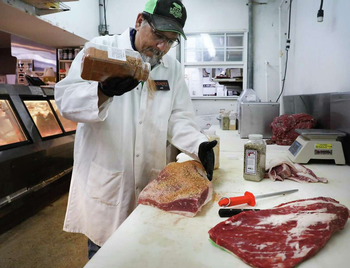 Joe Doria, Market Manager at Bolner's Meat Market, applies seasoning as a dry rub to a brisket on Tuesday, July 16, 2019.> > Best stops for food off Interstate 10 from El Paso to Beaumont