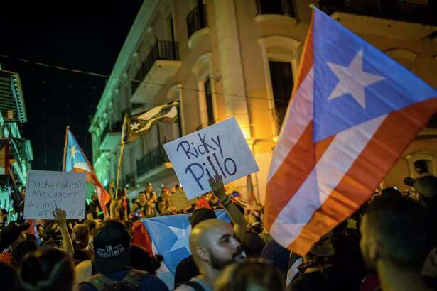 Demonstrators in front of La Fortaleza Mansion in Old San Juan, Puerto Rico, on Friday deman the resignation of Gov. Ricardo Rossello.