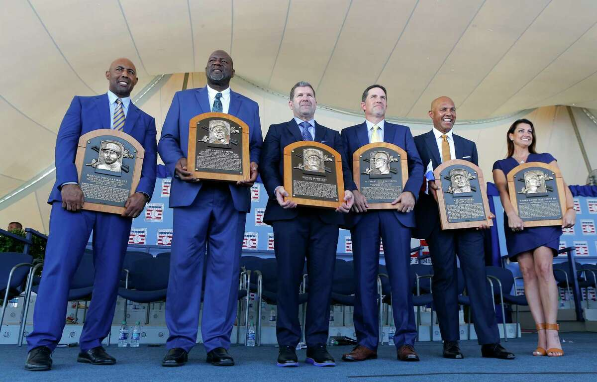 COOPERSTOWN, NEW YORK - JULY 21: Inductees (from left) Harold Baines, Lee Smith, Edgar Martinez, Mike Mussina, Mariano Rivera and Brandy Halladay, wife the late Roy Halladay, pose with their plaques during the Baseball Hall of Fame induction ceremony at Clark Sports Center on July 21, 2019 in Cooperstown, New York. (Photo by Jim McIsaac/Getty Images)
