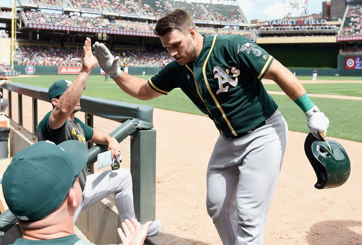 MINNEAPOLIS, MN - JULY 21: Josh Phegley #19 of the Oakland Athletics celebrates hitting a two-run home run against the Minnesota Twins during the fifth inning of the game on July 21, 2019 at Target Field in Minneapolis, Minnesota. The Twins defeated the Athletics 7-6. (Photo by Hannah Foslien/Getty Images)