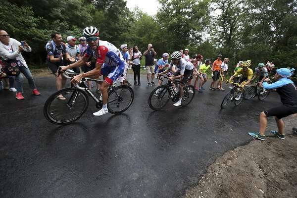 France's Thibaut Pinot, left, Colombia's Egan Bernal wearing the best young rider's white jersey, and France's Julian Alaphilippe wearing the overall leader's yellow jersey climb Prat d'Albis during the fifteenth stage of the Tour de France cycling race over 185 kilometers (114,95 miles) with start in Limoux and finish in Prat d'Albis, France, Sunday, July 21, 2019. (AP Photo/Thibault Camus)