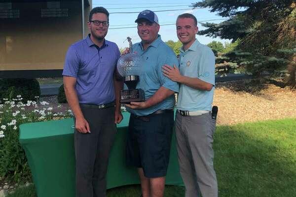 Danbury's Howie Busse, center, won the 29th Danbury Amateur at Richter Park on Sunday.