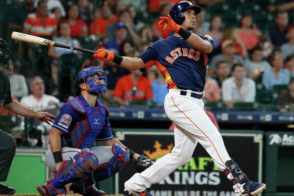 Michael Brantley connects on an eighth-inning home run, his second of the game, off the Rangers' Chris Martin in Sunday's 5-3 Astros victory.