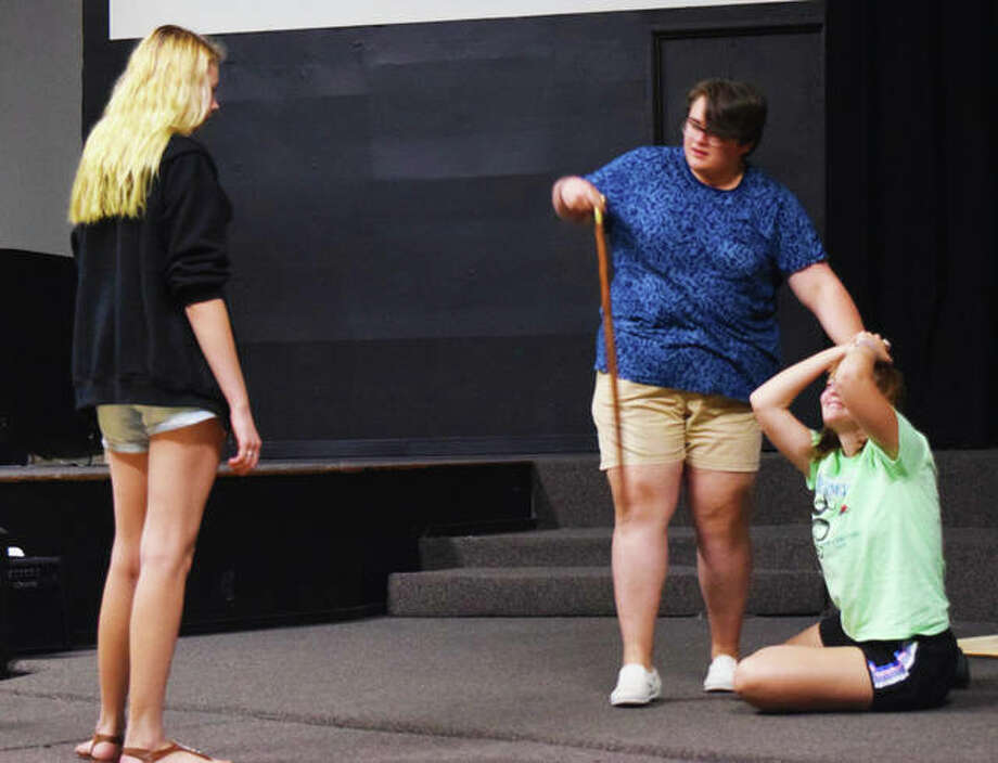 "Goshen Theatre Project director Halli Pattison works with castmembers Joshua Harris and Abby Ankrom, ahead of their August production of ""Les Miserables."" Photo: Tyler Pletsch 