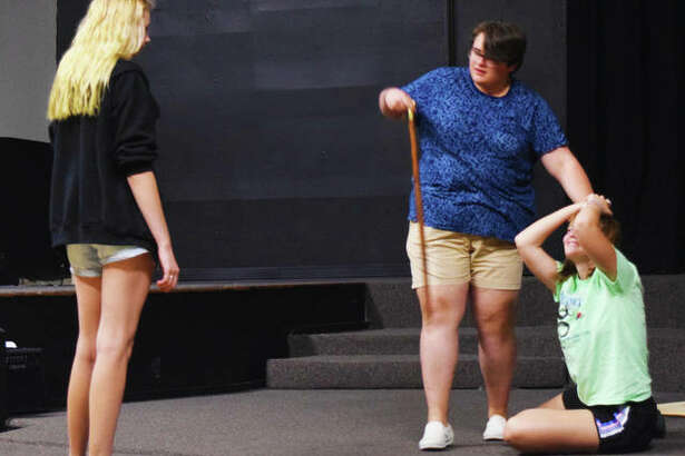 "Goshen Theatre Project director Halli Pattison works with castmembers Joshua Harris and Abby Ankrom, ahead of their August production of ""Les Miserables."""