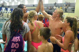 Members of the Montclaire swim team celebrate after taking first place in Sunday's SWISA Championship at Chuck Fruit Aquatic Center. The Marlins won the meet for the first time since 1989.