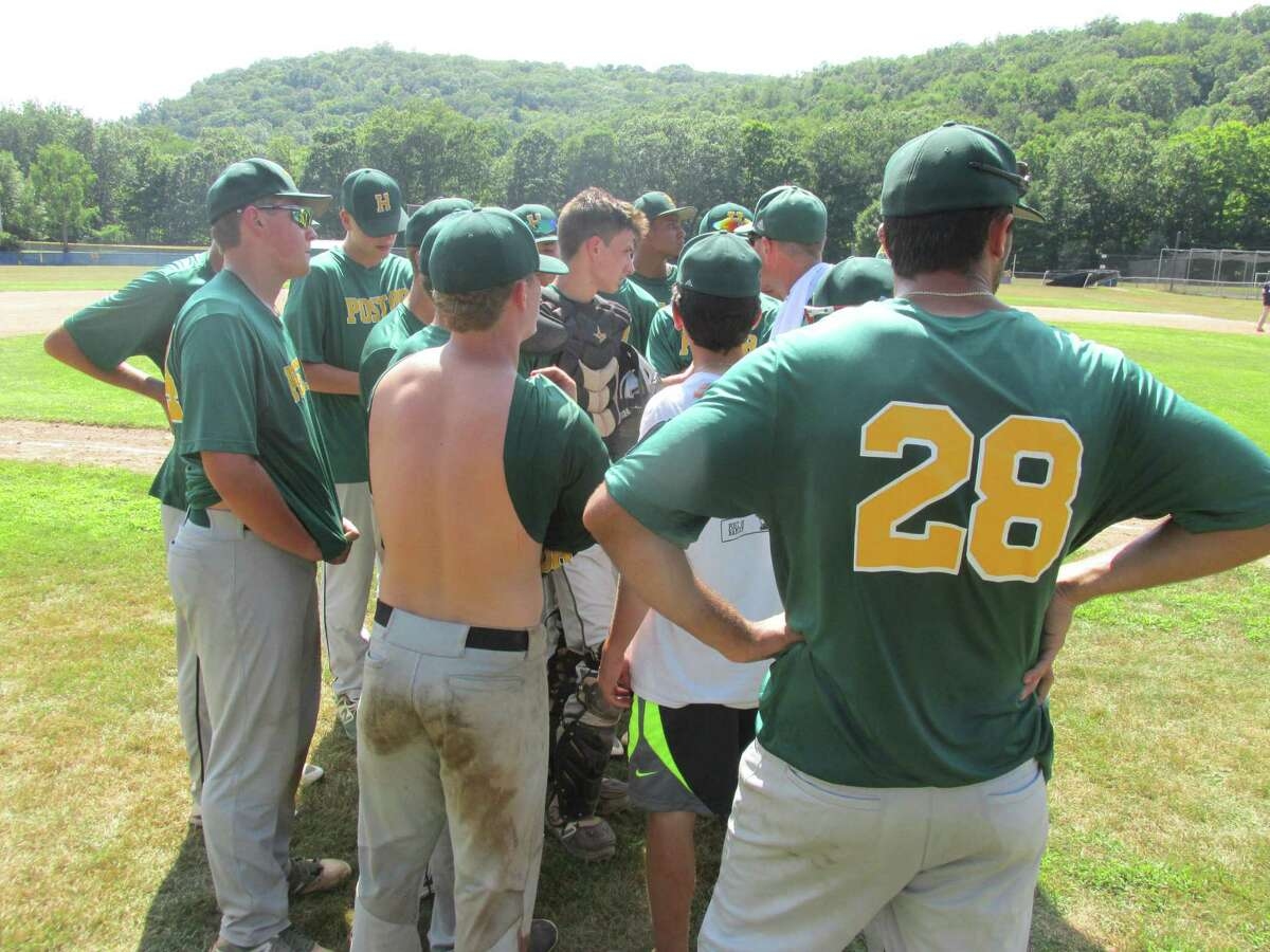 Hamden rallies around Coach Ray Guarino after its American Legion baseball state tournament second-round win over Washington Sunday afternoon at Ted Alex Field