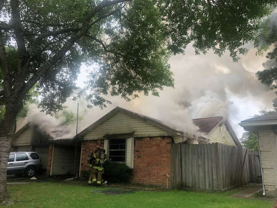 An elderly woman was hospitalized with severe burns on Sunday after a home in Spring caught fire. Emergency crews were dispatched around 6 p.m. to the home in the 22500 block of Leafygate Drive, in the subdivision of Greengate, the Harris County Precinct 4 Constable's Office said. It was not immediately clear what caused the fire, or the extent of the woman's injuries. Photo: Courtesy Of  The Harris County Precinct 4 Constable's Office