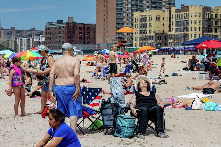 Visitors at Brighton Beach in Brooklyn, July 21, 2019. New York, like much of the country, has been in the grip of a heat wave, pushing officials in the city to declare a state of emergency lasting through the weekend. (Stephen Speranza/The New York Times) Photo: STEPHEN SPERANZA / NYTNS