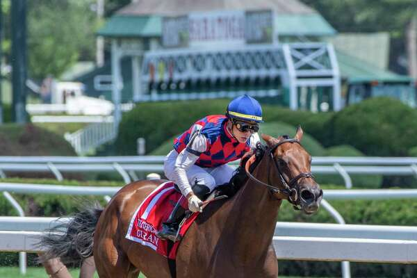 Guarana ridden by Jose Ortiz pulls ahead of the field to win the 103rd running of the Coaching Club American Oaks Sunday July 21, 2019 at the Saratoga Race Course in Saratoga Springs, N.Y. Special to the Times Union by Skip Dickstein