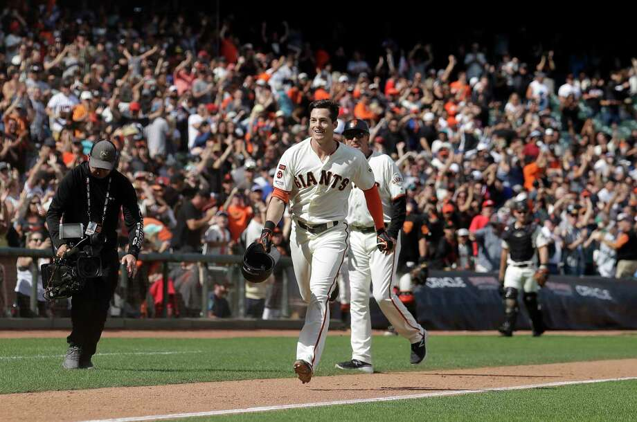 San Francisco Giants' Mike Yastrzemski, center, celebrates after hitting a solo home run against the New York Mets during the 12th inning of a baseball game in San Francisco, Sunday, July 21, 2019. (AP Photo/Jeff Chiu) Photo: Jeff Chiu / Copyright 2019 The Associated Press. All rights reserved