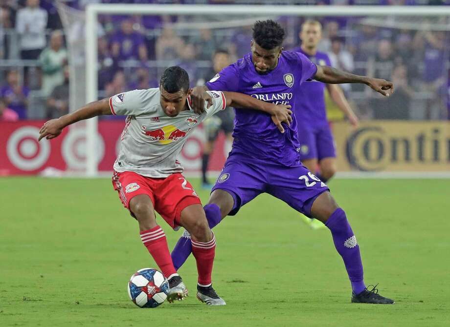 New York Red Bulls' Cristian Casseres Jr, left, and Orlando City's Carlos Ascues battle for possession of the ball during the first half of an MLS soccer match, Sunday, July 21, 2019, in Orlando, Fla. (AP Photo/John Raoux) Photo: John Raoux / Copyright 2019 The Associated Press. All rights reserved